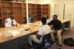 Dre and Josh chopping it up with the Chief.