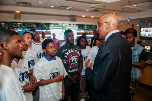 Charlotte Hornets COO Fred Whitfield speaking with RISE during the Bobcats 76ers game.